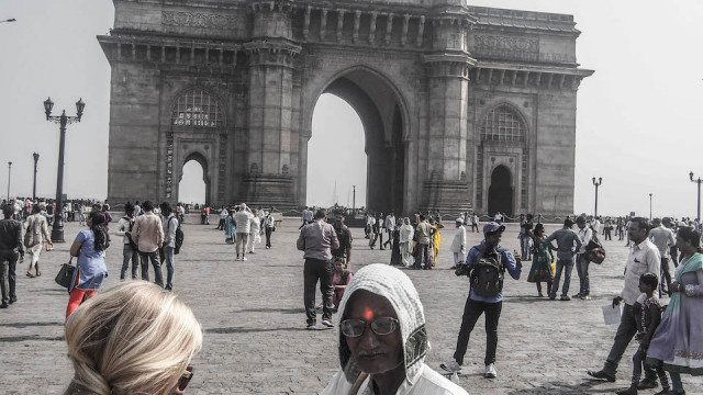 "Anne getting a ""blessing"" near the Gateway of India"