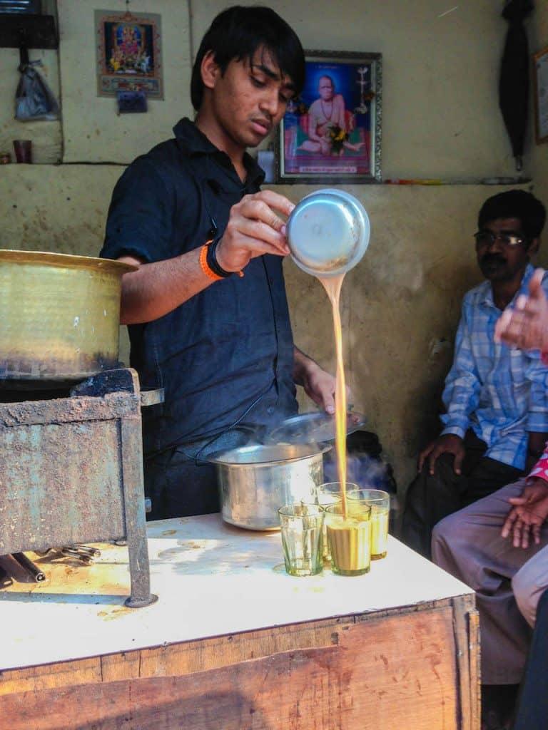 Mumbai Chai wallah serving his customers
