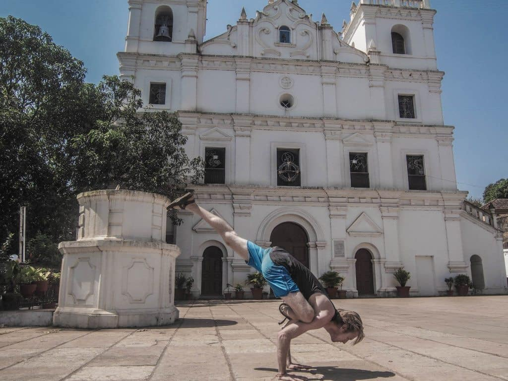 Flying Squirrel pose - near a beautiful Aldona Church