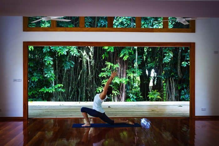 girl doing crescent moon yoga pose