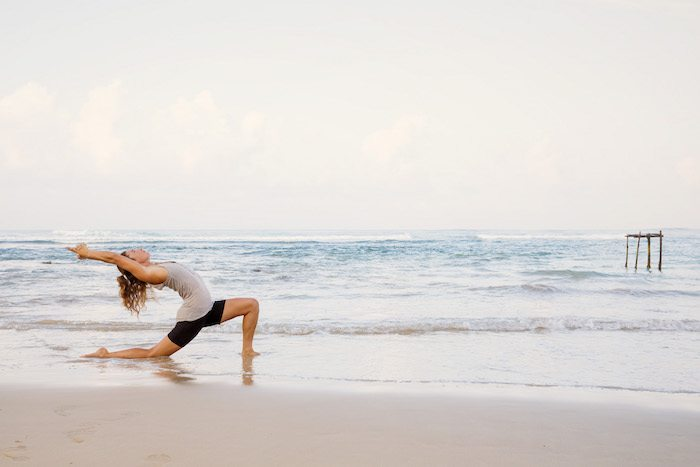 yoga on the beach - crescent moon pose - lucy foster perkins