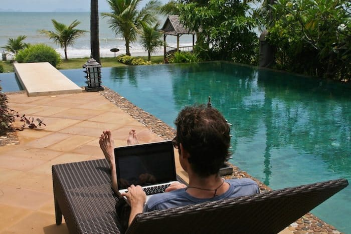 Simon working by the pool of our beachfront villa in Koh Lanta, Thailand. May 2012.
